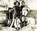 Inuit actress Columbia Eneutseak with family, 1911.jpeg