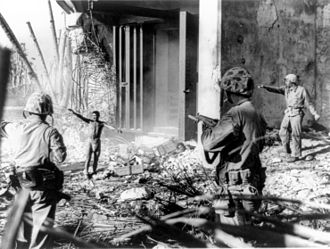 Japanese prisoners of war in World War II - A Japanese soldier surrendering to three US Marines in the Marshall Islands during January 1944.