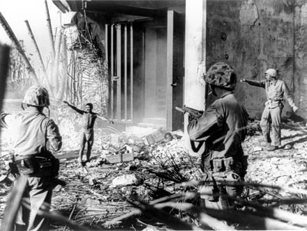A Japanese soldier surrendering to three U.S. Marines in the Marshall Islands during January 1944. Japanesesurrendermarshallislands.jpg