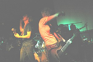 Jebediah - Jebediah, performing in November 2007. Left to right: Daymond (darkened), Kevin Mitchell, Brett Mitchell (obscured behind his drum kit), Vanessa Thornton.