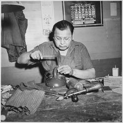 Jesse Cornplanter, descendant of Cornplanter, the famous Seneca chief, making a ceremonial mask, Tonawanda Community Hou - NARA - 519161.tif
