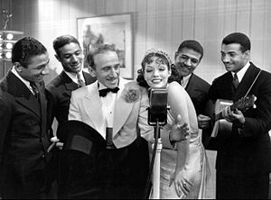 Strictly Dynamite - Jimmy Durante, Lupe Velez and the Mills Brothers in a scene from the film.