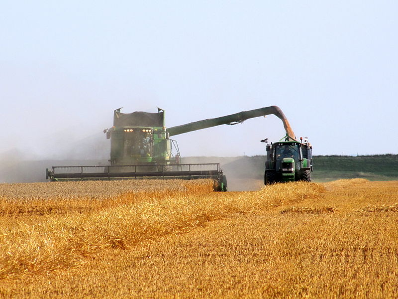 File:John Deere combine and tractor at work.jpg