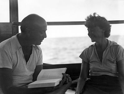 John Dos Passos reads aloud to Katy Dos Passos(?) aboard the Anita, 1932.jpg