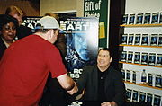 Travolta signing copies of Battlefield Earth, 2000