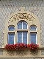 Kőbánya Town Hall, bird relief and window, 2016 Budapest.jpg