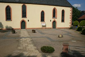 Wetterau Limes - Bathhouse of Echzell Roman Fort in the paving in front of the church.