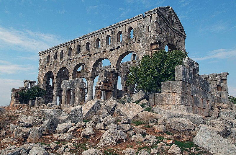 https://upload.wikimedia.org/wikipedia/commons/thumb/e/e1/Kharab_Shams_Basilica%2C_Dead_Cities_region%2C_NW_Syria.jpg/800px-Kharab_Shams_Basilica%2C_Dead_Cities_region%2C_NW_Syria.jpg