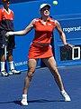 Kim Clijsters forehand 2003.jpg