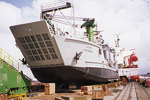 LCU 2000 being loaded as deck cargo on a chartered vessel