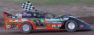Racing flags - Late model stock car driver celebrates with a checkered flag