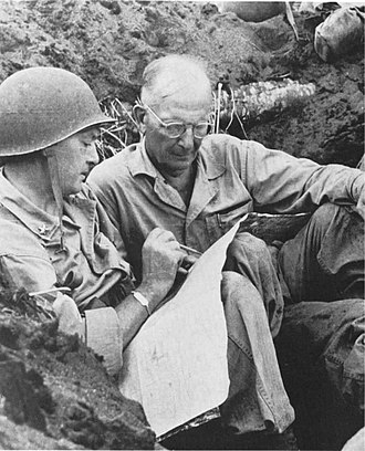 John T. Selden - During operations to clear the enemy from the shores of Borgen Bay, New Britain; BG Lemuel C. Shepherd, (left) 1st Marine Division Assistant Commander, confers with COL John T. Selden (5th Marines).