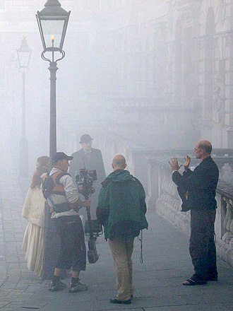 Steadicam - To film this recreated Victorian London street scene, the Steadicam operator is next to the lamp post, wearing a leather Steadicam vest.