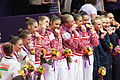 London 2012 Rhythmic Gymnastics - medal biting.jpg