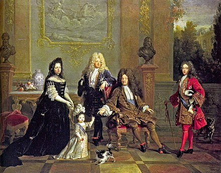 Louis XIV (seated) with his son le Grand Dauphin (to the left), his grandson Louis, Duke of Burgundy (to the right), his great-grandson Louis Duke of Anjou, and Madame de Ventadour, Anjou's governess, who commissioned this painting; busts of Henry IV and Louis XIII are in the background. Louis XIV of France and his family attributed to Nicolas de Largilliere.jpg