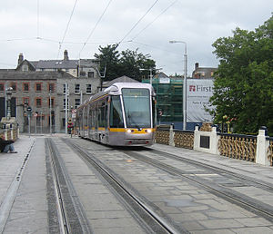 Seán Heuston Bridge - Luas tram crossing Heuston Bridge from Wolfetone Avenue towards Heuston station