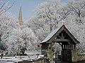 Lychgate and spire of St Wilfrid's Church, Brayton, North Yorkshire.jpg