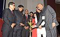 M.M. Pallam Raju lighting the lamp to inaugurate the International Conference on Community Colleges, in New Delhi. The Ministers of State for Human Resource Development.jpg