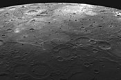 Lava-flooded craters and large expanses of smooth volcanic plains on Mercury.