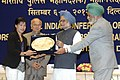 Manmohan Singh honours Smt. Mary Kom, the London Olympic Bronze Medal winner, at the All India Conference of Directors GeneralInspectors General of Police -2012, in New Delhi. The Union Home Minister.jpg