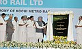 Manmohan Singh unveiling the plaque to lay the foundation stone of the Kochi Metro, in Kochi. The Governor of Kerala, Dr. H.R. Bhardwaj, the Chief Minister of Kerala.jpg