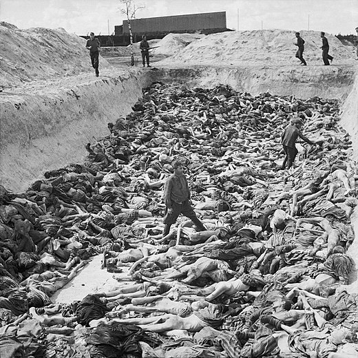 Fritz Klein, the camp doctor, standing in a mass grave at Bergen-Belsen after the camp's liberation by the British 11th Armoured Division, April 1945 Mass Grave at Bergen-Belsen concentration camp - Fritz Klein - IWM BU4260.jpg