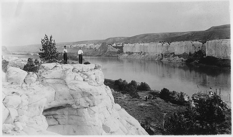 Men on the bluffs overlooking the Missouri River and the boat - NARA - 285911.jpg