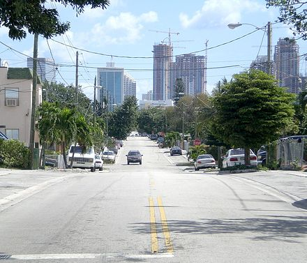 View from one of the higher points in Miami, west of downtown. The highest natural point in the city of Miami is in Coconut Grove, near the bay, along the Miami Rock Ridge at 24 feet (7.3 m) above sea level. Miamihighpoint.jpg