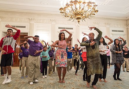 Michelle Obama joining students for a Bollywood dance clinic in the White House State Dining Room, 2013 Michelle Obama joins students for a Bollywood Dance Clinic in White House.jpg