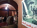 Millstone in Spice Shop - With Old Photo of Camel Pulling Stone - Bazaar - Kashan - Central Iran (7453840132) (2).jpg