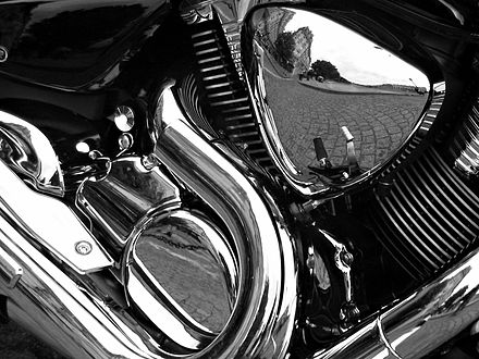 Decorative chrome plating on a motorcycle. Motorcycle Reflections bw edit.jpg