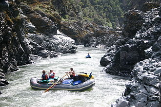 Klamath Mountains - Rafters on the Rogue River in the northern Klamath Mountains in southwestern Oregon