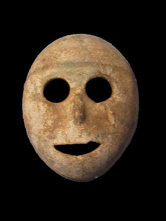 Mask - This stone mask from the pre-ceramic neolithic period dates to 7000 BC and is probably the oldest mask in the world (Musée de la Bible et de la Terre Sainte)