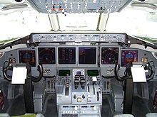The Boeing 717-200 flight deck, showing the two-crew cockpit and six LCD  units