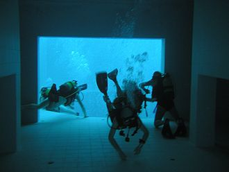 Nemo 33 - An underwater house at Nemo, with the 34.5 m deep pit in the background