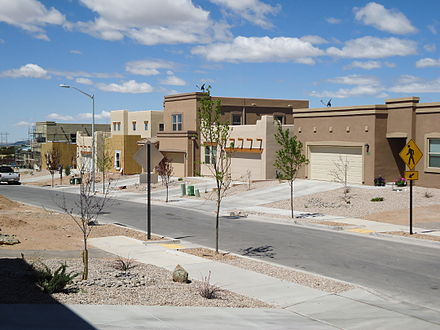 Homes are territorial- or pueblo-style and stuccoed with flat roofs, 2011. NM 2.JPG