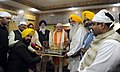 Narendra Modi being presented a Miniature Model of the Golden Temple, in Amritsar, Punjab on March 23, 2015. The Chief Minister of Punjab, Shri Parkash Singh Badal and other dignitaries are also seen.jpg