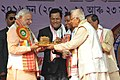 Narendra Modi being presented a meemnto at the 85th Annual Conference of Srimanta Sankaradeva Sangha, at Sibasagar, Assam. The Minister of State for Youth Affairs and Sports (Independent Charge) (1).jpg
