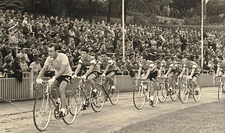 Gaul (left) wearing the race leader's yellow jersey at the 1958 Tour de France, leading the combined Netherlands and Luxembourg team Nelux Equipe 1958 um Stadion 1.jpg