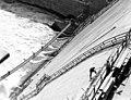 Norris Dam (1936) - Construction worker facing dam (9134563415).jpg