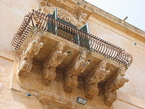 Noto - A balcony of the Villadorata palace.