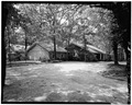 OBLIQUE VIEW OF FRONT ELEVATION FROM DRIVEWAY - Jimmy Carter House, 209 Woodland Drive, Plains, Sumter County, GA HABS GA,131-PLAIN,2-4.tif