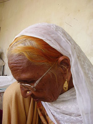 Henna - Elderly Punjabi woman whose hair is dyed with henna.