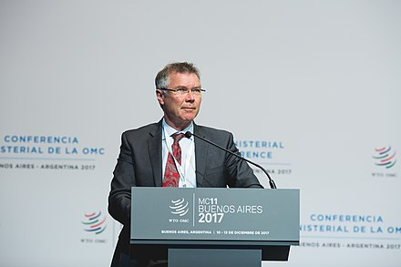 As Minister of Economic Development, Parker addresses the WTO Ministerial Conference in December 2017 Opening plenary session, 11 December 2017 (27239254379).jpg