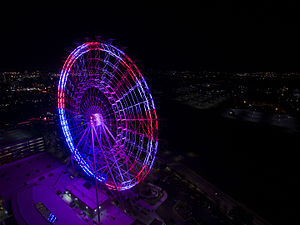 Orlando Eye - This aerial image was taken on September 11, 2015 when the Orlando Eye was displaying patriotic colors.