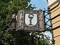 Országzászló Pharmacy signboard on a listed residential building ID 3873 Copper, wrought iron and neon lighting. By Mary Ecsedi, 1997. - 1, Országzászló Sq., Fő Street corner, Downtown, Székesfehérvár, Fejér county.JPG