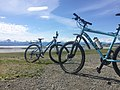 Our Mountain Bikes at Eagle Beach, with Chilkat Mtn Range (bkgd) (35596953172).jpg