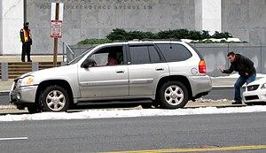 Parallel parking - A motorist gets assistance parallel-parking