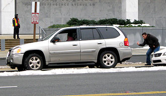 Parallel parking - A motorist gets assistance parallel-parking
