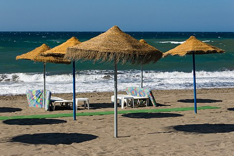 Parasols beach furniture Beach Rincon de la Victoria Andalusia Spain